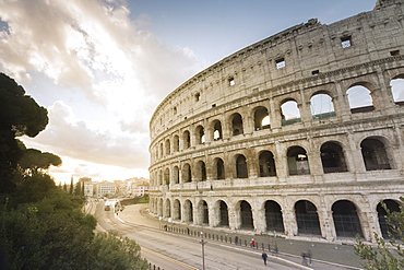 The lights of sunrise frame the ancient Colosseum (Flavian Amphitheatre), UNESCO World Heritage Site, Rome, Lazio, Italy, Europe