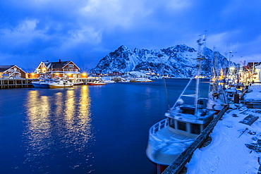 The lights of the harbor of Henningsvaer, the most important in the Lofoten, lit at the blue hour, Lofoten Islands, Arctic, Norway, Scandinavia, Europe