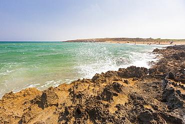 The waves of turquoise sea crashing on the rocks, Pozzallo, Province of Ragusa, Sicily, Italy, Mediterranean, Europe