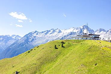 Green meadows and rocky peaks frame the Rifugio Doss Del Sabion, Pinzolo, Brenta Dolomites, Trentino-Alto Adige, Italy, Europe