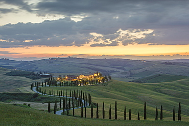 Dusk on green hills surrounded by cypresses and farm houses, Crete Senesi (Senese Clays), province of Siena, Tuscany, Italy, Europe