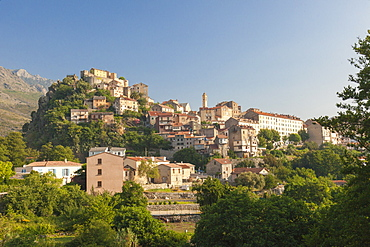 The old citadel of Corte perched on the hill surrounded by mountains, Haute-Corse, Corsica, France, Europe