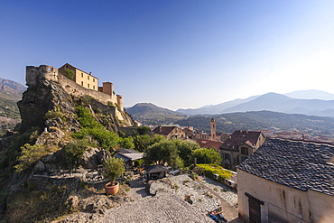 View of the old town of citadel of Corte perched on the hill surrounded by mountains, Haute-Corse, Corsica, France, Europe