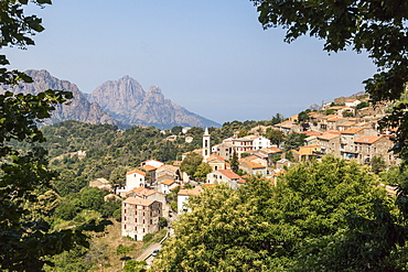 The old citadel of Evisa perched on the hill surrounded by mountains, Southern Corsica, France, Europe