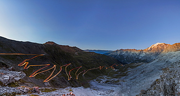 Panorama of lights of car trace at dusk, Stelvio Pass, Valtellina, Lombardy, Trentino Alto Adige, Italy, Europe