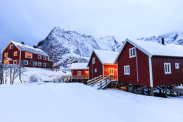 Fresh snow on the typical Norwegian homes, the Rorbu, once fishermen's home, now tourist accommodation, Lofoten Islands, Arctic, Norway, Scandinavia, Europe