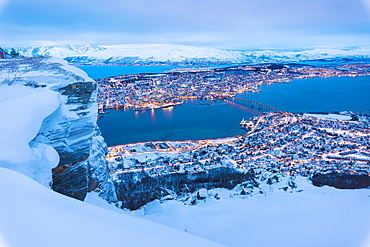 View of the city of Tromso at dusk from the mountain top reached by the Fjellheisen cable car, Troms, Northern Norway, Scandinavia, Europe