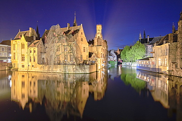 The medieval Belfry and historic buildings reflected in Rozenhoedkaai canal at night, UNESCO World Heritage Site, Bruges, West Flanders, Belgium, Europe