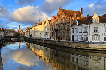 Pink clouds at dawn on the Belfry and historic buildings reflected in the typical canal, Bruges, West Flanders, Belgium, Europe