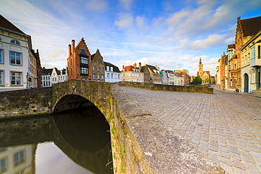 Pink clouds at dawn on the typical buildings and quay along the typical canal, Bruges, West Flanders, Belgium, Europe
