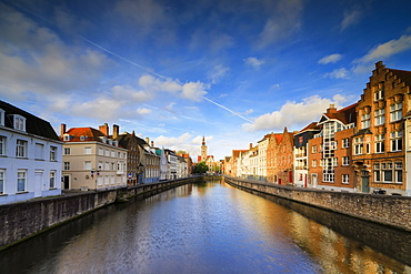 Bright sky at dawn on historic buildings and houses of city centre reflected in the canal, Bruges, West Flanders, Belgium, Europe