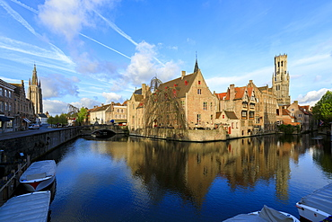 First light of dawn on the Belfry and historic buildings reflected in the typical canal, Bruges, UNESCO World Heritage Site, West Flanders, Belgium, Europe