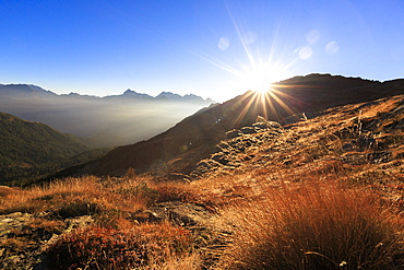 Sunbeams on alpine pastures with peak Scalino in the background, Val Torreggio, Malenco Valley, Valtellina, Lombardy, Italy, Europe