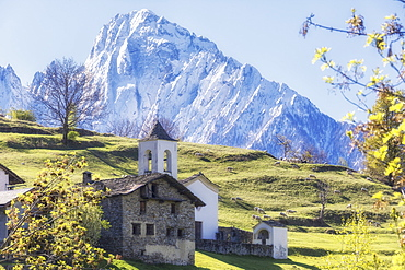 Alpine church framed by the snowy peak of Pizzo di Prata in spring, Daloo, Chiavenna Valley, Valtellina, Lombardy, Italy, Europe