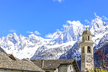 Blue sky in spring on bell tower and stone roofs, Soglio, Maloja, Bregaglia Valley, Engadine, canton of Graubunden, Switzerland, Europe
