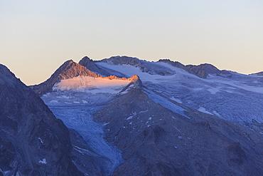 View of the Pisgana glacier and rocky peaks at dawn, Valcamonica, border Lombardy and Trentino-Alto Adige, Italy, Europe