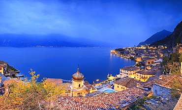Panorama of Lake Garda and the typical town Limone Sul Garda at dusk, province of Brescia, Italian Lakes, Lombardy, Italy, Europe