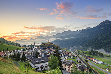 Pink clouds at dawn on the alpine village of Ardez, canton of Graub?nden, district of Inn, lower Engadine, Switzerland, Europe