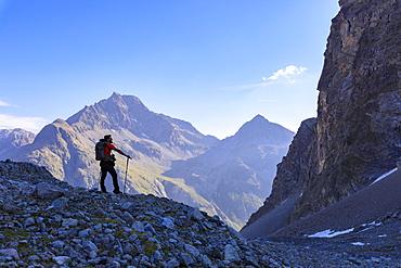 Hiker on the trail to Lej Lagrev, St. Moritz, Upper Engadine, Canton of Graubunden, Switzerland, Europe