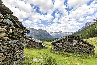 Typical alpine stone huts, Entova Alp, Malenco Valley, Sondrio province, Valtellina, Lombardy, Italy, Europe