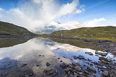 Piz Arlas, Cambrena, Caral reflected in lake, Bernina Pass, Poschiavo Valley, Engadine, Canton of Graubunden, Switzerland, Europe