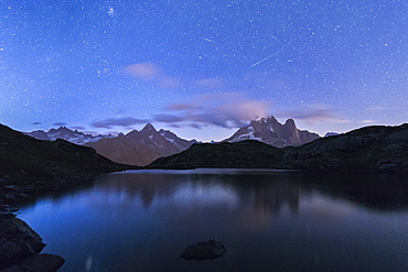 Shooting stars on the rocky peaks of Les Drus and Aiguille Verte, Lacs De Cheserys, Chamonix, Haute Savoie, French Alps, France, Europe