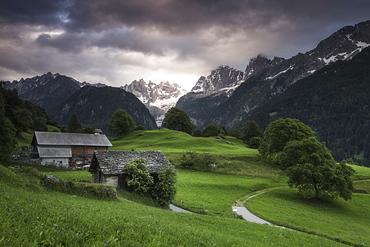 Clouds at dawn, Soglio, Bregaglia Valley, Maloja Region, Canton of Graubunden (Grisons), Switzerland, Europe