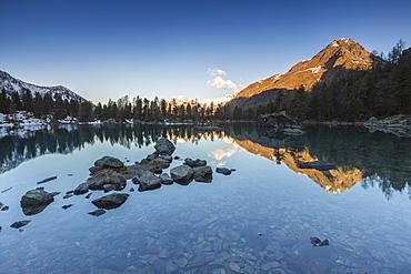 Corn Da Murasciola reflected in Lago di Saoseo, Val di Campo, Poschiavo region, Canton of Graubunden, Switzerland, Europe
