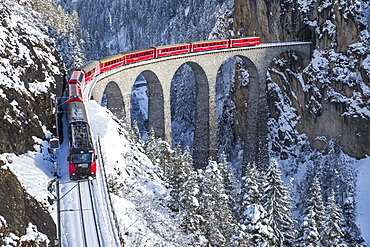 The red train of the Albula-Bernina Express Railway, UNESCO World Heritage on the Landwasser Viaduct, Switzerland, Europe