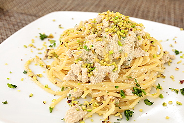Pasta on platter with swordfish eggs garnished with Bronte pistachio, Sicily, Italy, Europe