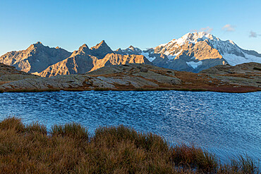 Alpine lake with Monte Disgrazia on background, Alpe Fora, Malenco Valley, province of Sondrio, Valtellina, Lombardy, Italy