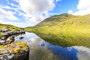 Mountains reflected in water, Killarney National Park, County Kerry, Munster, Republic of Ireland, Europe