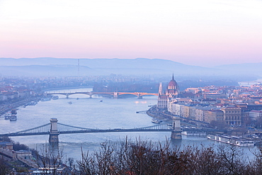 View over the city and River Danube at sunset from The Citadel on Gellert Hill, Budapest, Hungary, Europe