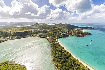 Aerial view of a lagoon on the Caribbean island of Antigua a thin line of sand divides the small salt basin from the sea, Antigua, Leeward Islands, West Indies, Caribbean, Central America