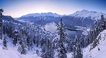 Panoramic of village and Lake of St. Moritz covered with snow, Engadine, Canton of Graubunden, Switzerland, Europe