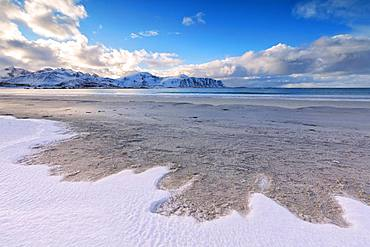 Snow on sandy beach, Ramberg, Flakstad municipality, Lofoten Islands, Nordland, Norway, Europe