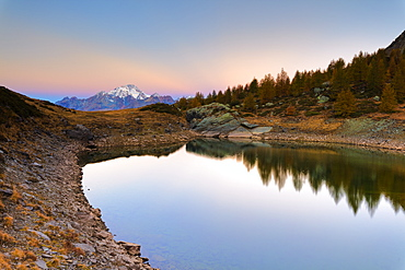 Autumnal sunrise on Monte Disgrazia and Lakes of Campagneda, Valmalenco, Valtellina, Sondrio province, Lombardy, Italy, Europe