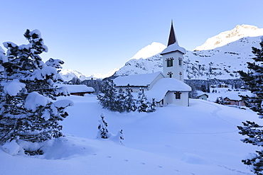 Chiesa Bianca surrounded by snow, Maloja, Bregaglia Valley, Engadine, Canton of Graubunden, Switzerland, Europe