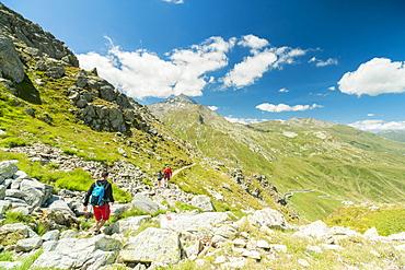 Hikers on footpath towards Pizzo Tambo, Spluga Pass, canton of Graubunden, Switzerland, Europe
