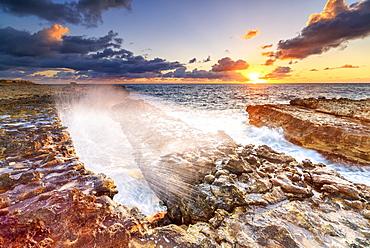 Waves crashing on cliffs at sunrise, Devil's Bridge, Antigua, Antigua and Barbuda, Leeward Islands, West Indies, Caribbean, Central America