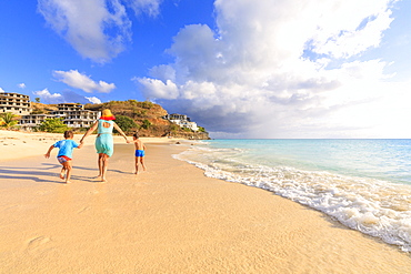 Woman and children running happily on Ffryes Beach, Antigua, Antigua and Barbuda, Leeward Islands, West Indies, Caribbean, Central America