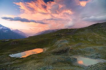 Sunset over the alpine lake of Riffelsee, Zermatt, canton of Valais, Swiss Alps, Switzerland, Europe