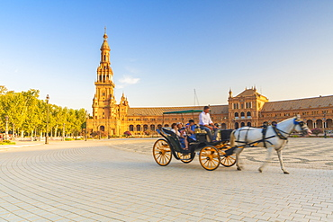 Tourists in horse carriage, one of the major attractions for visitors, Plaza de Espana, Seville, Andalusia, Spain, Europe