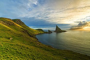 Drangarnir rock seen from the green hills along the hiking trail, Vagar island, Faroe Islands, Denmark, Europe