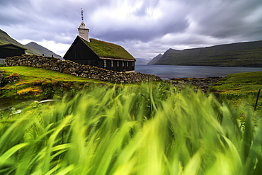 Church with traditional grass roof, oceanfront, Funningur, Eysturoy island, Faroe Islands, Denmark, Europe