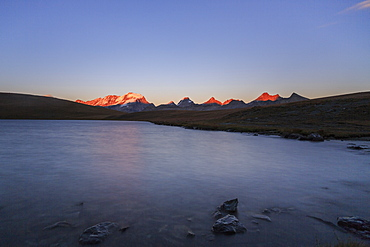 Sunset on Rossett Lake at an altitude of 2709 meters. Gran Paradiso National Park, Alpi Graie (Graian Alps), Italy, Europe