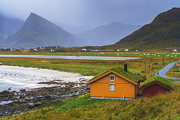 Houses with grass roof by the sea, Fredvang, Nordland county, Lofoten Islands, Norway, Europe