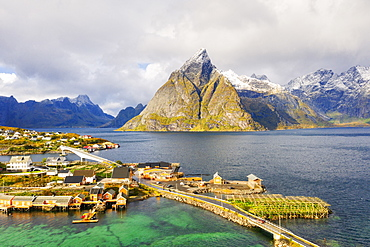 Sakrisoy village surrounded by mountains and crystal sea, Reine, Nordland, Lofoten Islands, Norway, Europe