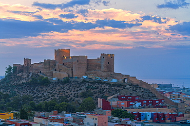 The Alcazaba old Moorish castle and fortress on hilltop at sunrise, Almeria, Andalusia, Spain