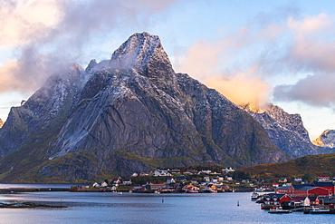 Olstinden mountain above town at sunset in Reine, Moskenes, Norway, Europe